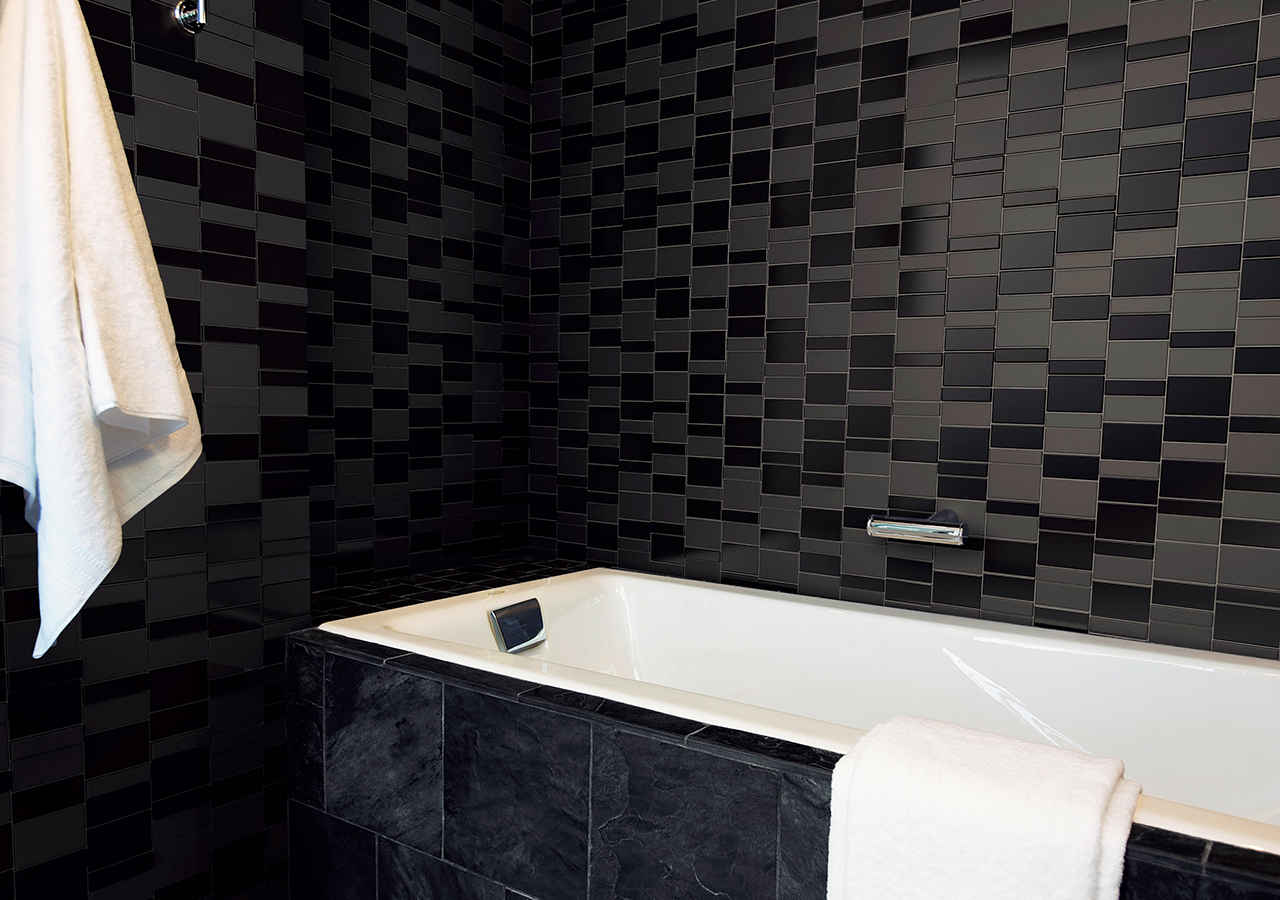 FORMAT-MIX by inax tile showcasing a bathroom in all black. ajami surfaces in miami