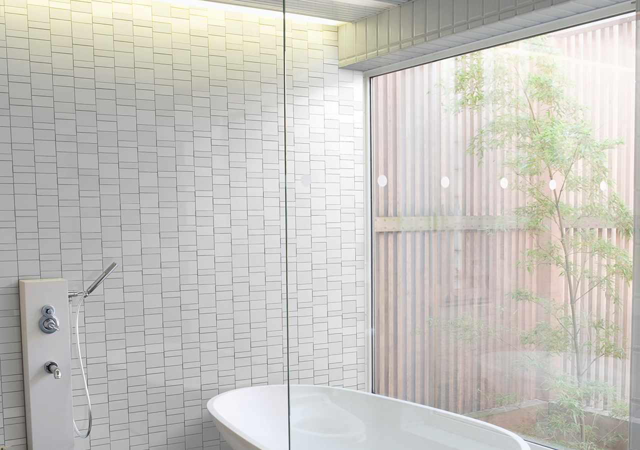 FORMAT-MIX in white by inax tile in a bathroom. found in ajami surfaces flooring and granite in miami